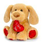 25 cm-es pihe-puha plüss kutyus szívvel a szájában